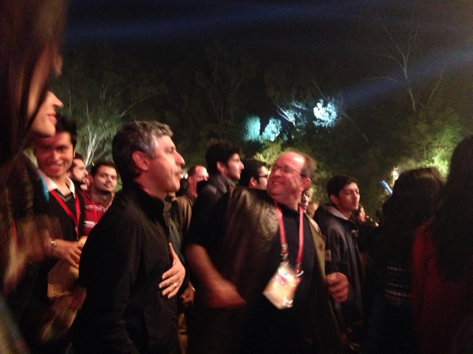 No wonder he's so happy. William Dalrymple swinging it while Reza Aslan looks on at a musical performance. Image copyright: Kiran Nazish.