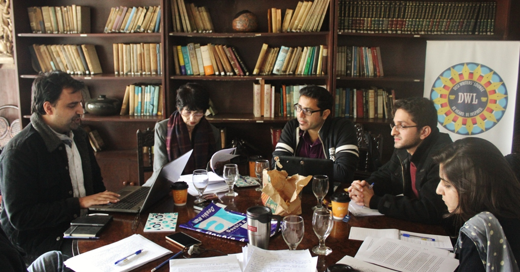 Bilal Shadani speaks as participants and instructor Usman T. Malik (centre) listen during the Sunday session of The Rising Dust speculative fiction workshop in Lahore.