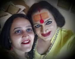 Red lipstick at home, red lipstick at work. Pooja and Laxmi while working on the book.