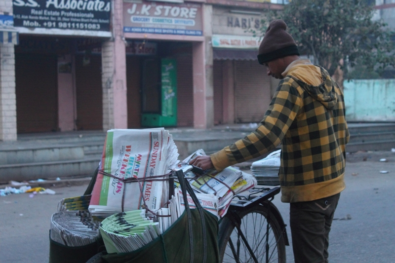 Of the few things that have endured the relentless onslaught of a digital revolution, is old-school home delivery of news from afar for Noida's residents, though Noida now boasts its own region-specific supplement. Photo by Simar Preet Kaur