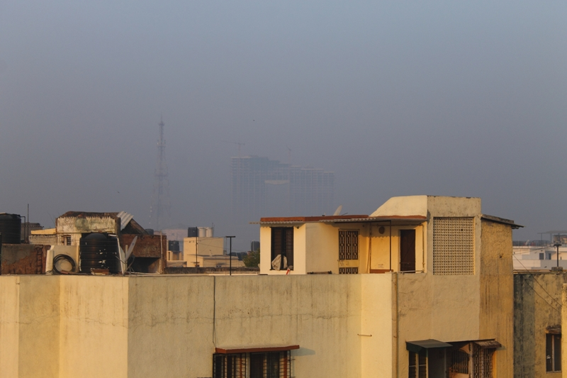 View from the author's former house terrace, where imaginary mountains have been replaced with the concrete skeleton of an upcoming office complex. Photo by Simar Preet Kaur