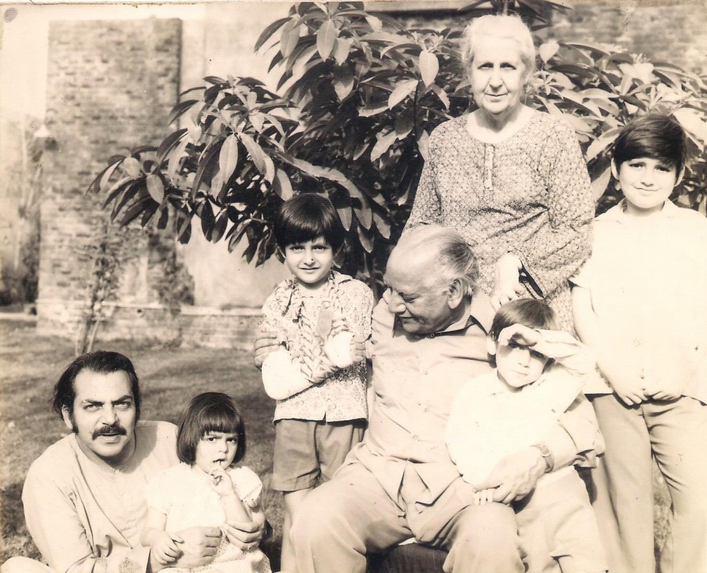 Faiz and Alys with son-in-law Shoaib Hashmi and grandchildren, in the back garden. Photo by Mira Hashmi